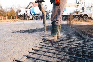 Concrete worker laying a foundation for a business in Huntersville